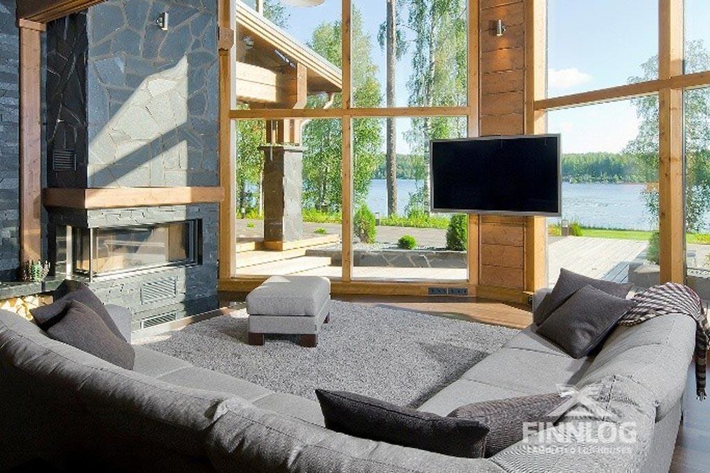 Draco Blockhaus - Wohnbereich mit Sitzecke und Kamin